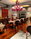 Le Grill Restaurant, Chef Marek�s workplace, is a beautiful world of blissful contrasts through architectural divergences. A rather large red Baroque style chandelier hangs low off the ceiling, calling to mind rich, hot, passionate romance, as any Feng Shui practitioner would know...